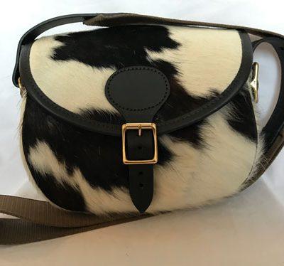 cow hide cartridge bag